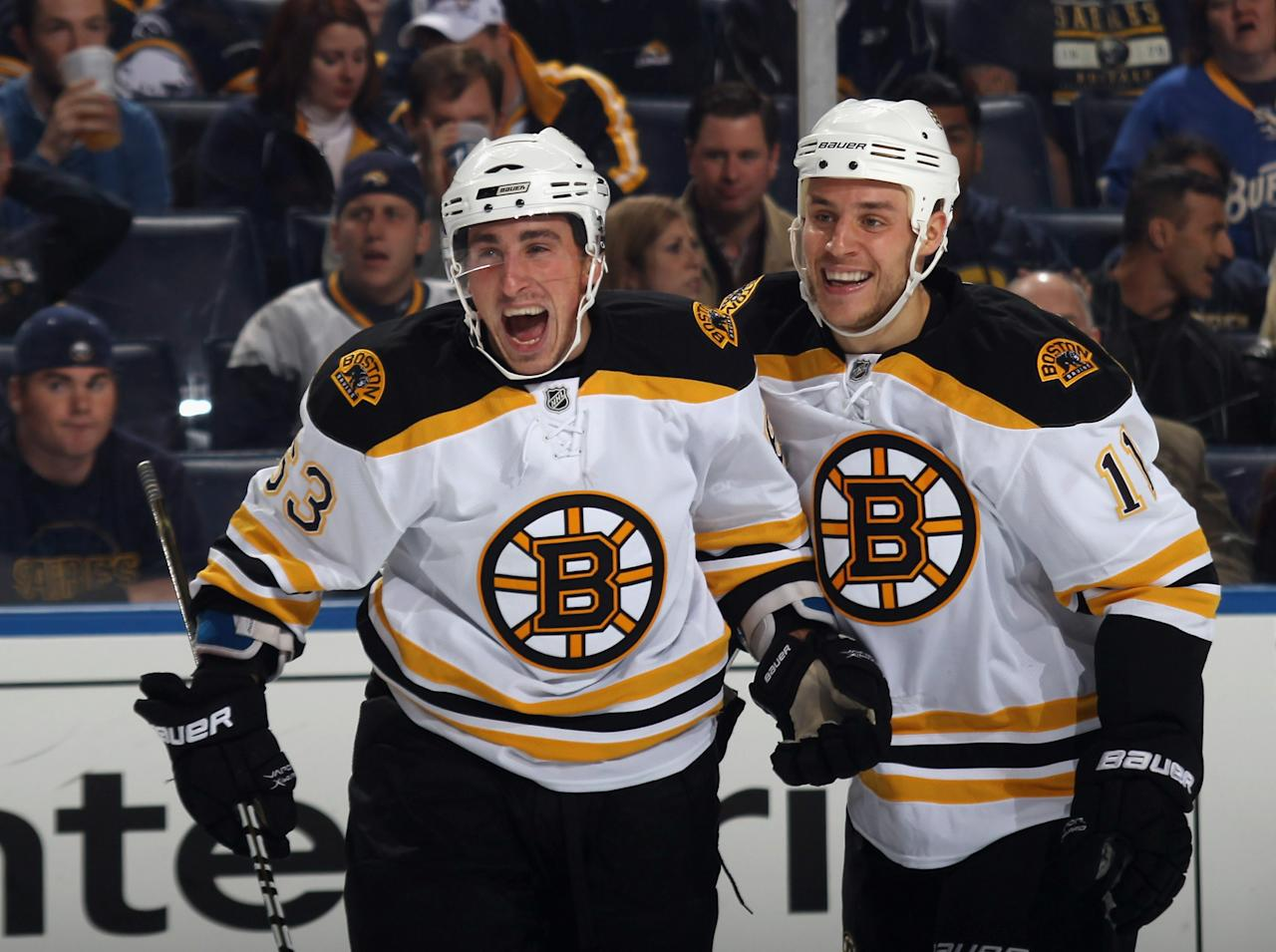 BUFFALO, NY - NOVEMBER 03:  Brad Marchand #63 (L) of the Boston Bruins scores his first NHL goal in the first period against the Buffalo Sabres and is joined by Gregory Campbell #11 (R) at the HSBC Arena on November 3, 2010 in Buffalo, New York.  The Bruins defeated the Sabres 5-2.(Photo by Bruce Bennett/Getty Images)