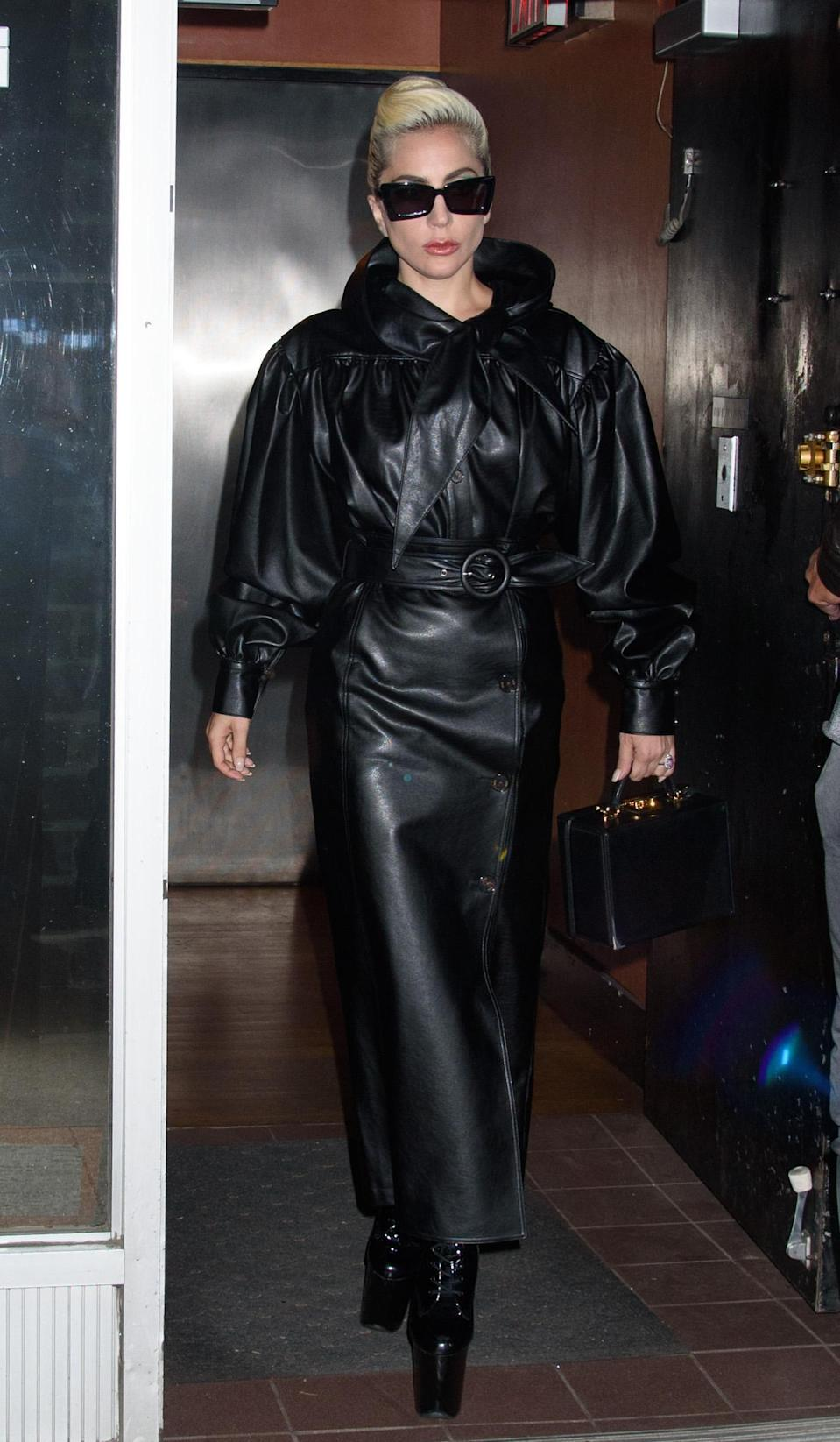 <p>Lady Gaga soon tossed aside office chic to channel the Matrix, and impress us with her ability to cope with the heat in all-leather. [Photo: Rex] </p>