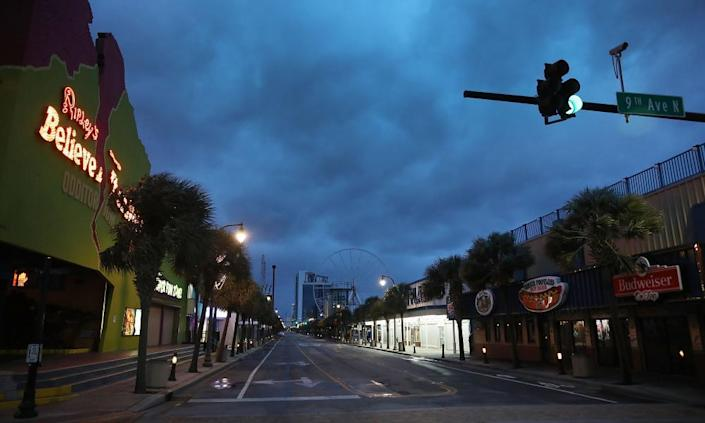 """<span class=""""element-image__caption"""">Clouds are seen over a deserted Ocean Boulevard as the force of Hurricane Florence is felt on Friday in Myrtle Beach.</span> <span class=""""element-image__credit"""">Photograph: Joe Raedle/Getty Images</span>"""