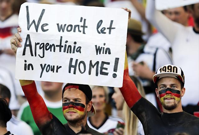 German supporters hold up a banner before the World Cup final soccer match between Germany and Argentina at the Maracana Stadium in Rio de Janeiro, Brazil, Sunday, July 13, 2014. (AP Photo/Matthias Schrader)