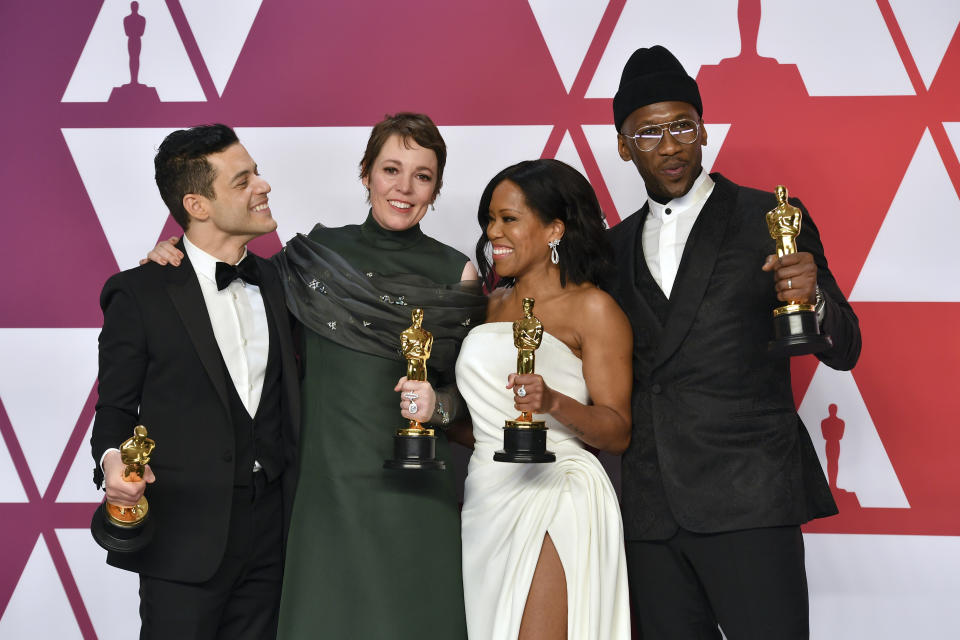 """Rami Malek, from left, winner of the award for best performance by an actor in a leading role for """"Bohemian Rhapsody"""", Olivia Colman, winner of the award for best performance by an actress in a leading role for """"The Favourite"""", Regina King, winner of the award for best performance by an actress in a supporting role for """"If Beale Street Could Talk"""", and Mahershala Ali, winner of the award for best performance by an actor in a supporting role for """"Green Book"""", pose in the press room at the Oscars on Sunday, Feb. 24, 2019, at the Dolby Theatre in Los Angeles. (Photo by Jordan Strauss/Invision/AP)"""