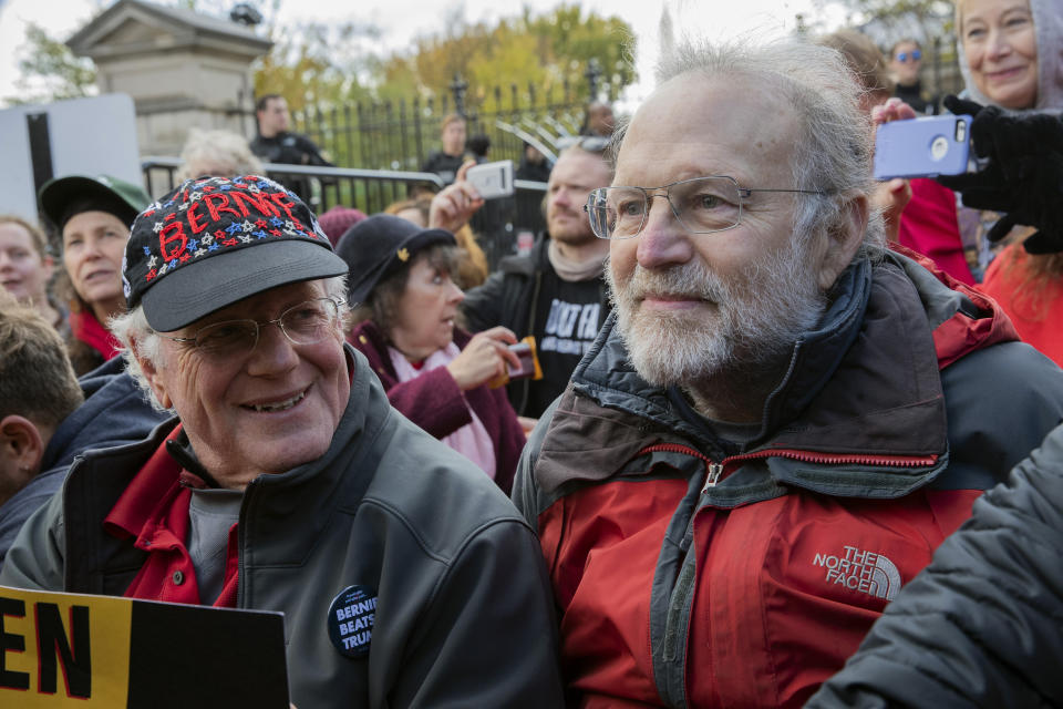Ben Cohen, left, and Jerry Greenfield, co-founders of Ben and Jerry's ice cream, protest against climate policies and to impeach President Donald Trump outside an entrance to the White House, Friday, Nov. 8, 2019, in Washington. (AP Photo/Patrick Semansky)