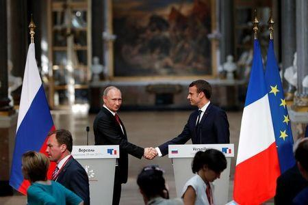 After talks, France's Macron hits out at Russian media, Putin denies hacking