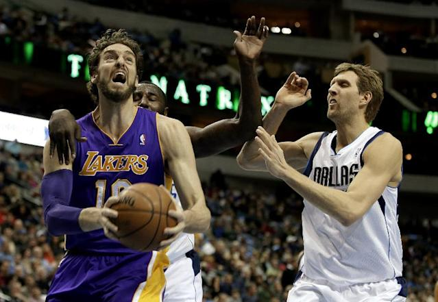 Los Angeles Lakers' Pau Gasol (16) of Spain gets by Dallas Mavericks' DeJuan Blair, left rear, and Dirk Nowitzki, right, on a drive to the basket in the first half of an NBA basketball game, Tuesday, Jan. 7, 2014, in Dallas. (AP Photo/Tony Gutierrez)