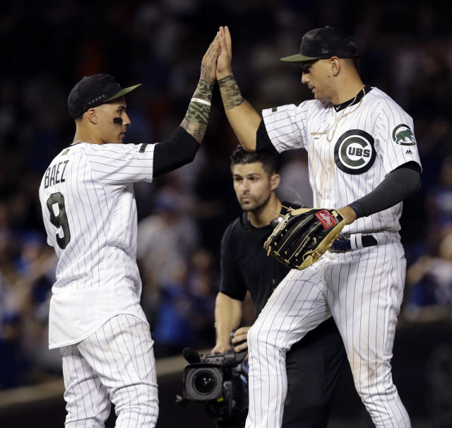 Chicago Cubs' Javier Baez, left, celebrates with Albert Almora Jr., after the Cubs defeated the San Francisco Giants 8-3 in a baseball game in Chicago, Sunday, May 27, 2018. (AP Photo/Nam Y. Huh)