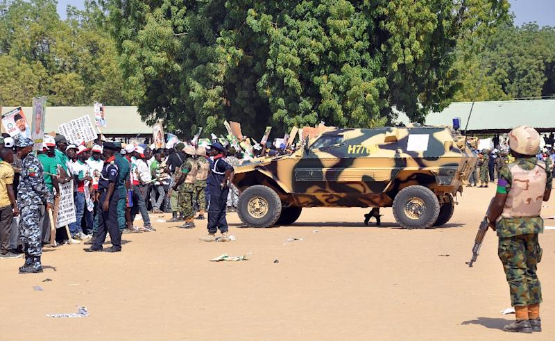 File photo shows police and soldiers blocking a road as they secure the venue during a rally of the ruling People's Democratic Party (PDP) in Maiduguri, northeast Nigeria on January 24, 2015