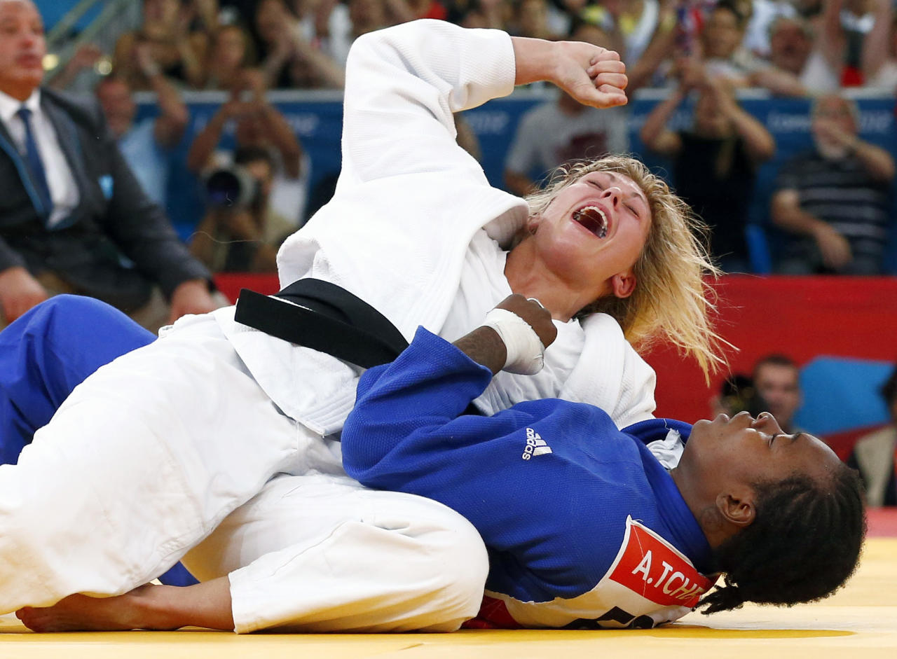 Britain's Gemma Gibbons celebrates after defeating France's Audrey Tcheumeo (blue) in their women's -78kg semi-final B judo match at the London 2012 Olympic Games August 2, 2012.                                    REUTERS/Darren Staples (BRITAIN  - Tags: OLYMPICS SPORT JUDO TPX IMAGES OF THE DAY)