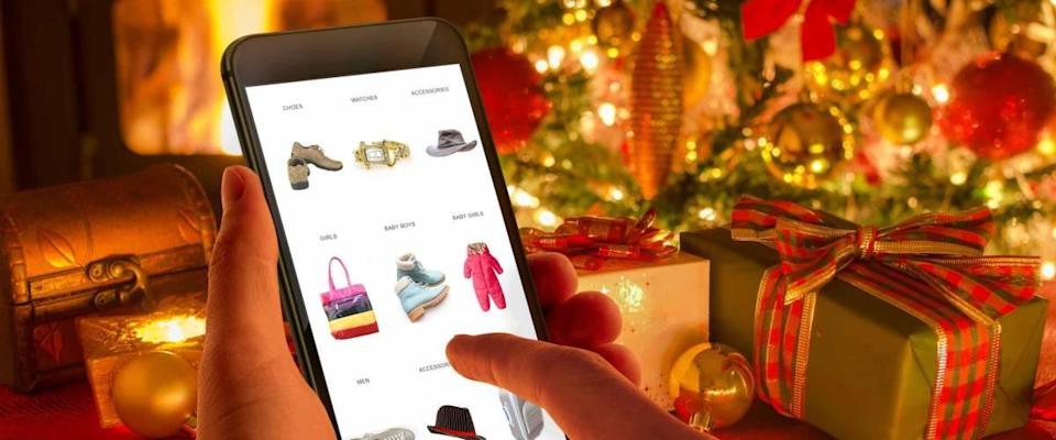 Christmas online shopping with phone.