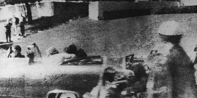 American President John F Kennedy (1917-1963) is struck by an assassin's bullet as he travels through Dallas in a motorcade on November 22, 1963. In the car next to him is his wife Jacqueline (1929-1994) and in the front seat is Texas Governor John Connally. Photo: Three Lions/Hulton Archive/Getty Images