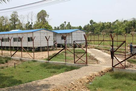 FILE PHOTO: A view from outside Taung Pyo Letwe reception camp near the border with Bangladesh, in Rakhine state, Myanmar, during a trip by United Nations envoys to the region May 1, 2018. REUTERS/Michelle Nichols/File Photo
