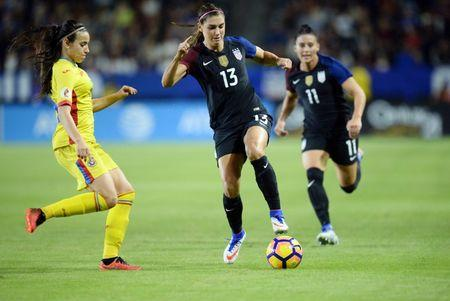 November 13, 2016; Carson, CA, USA;  USA forward Alex Morgan (13) moves the ball against Romania defender Teodora Meluta (15) during the second half at StubHub Center. Mandatory Credit: Gary A. Vasquez-USA TODAY Sports