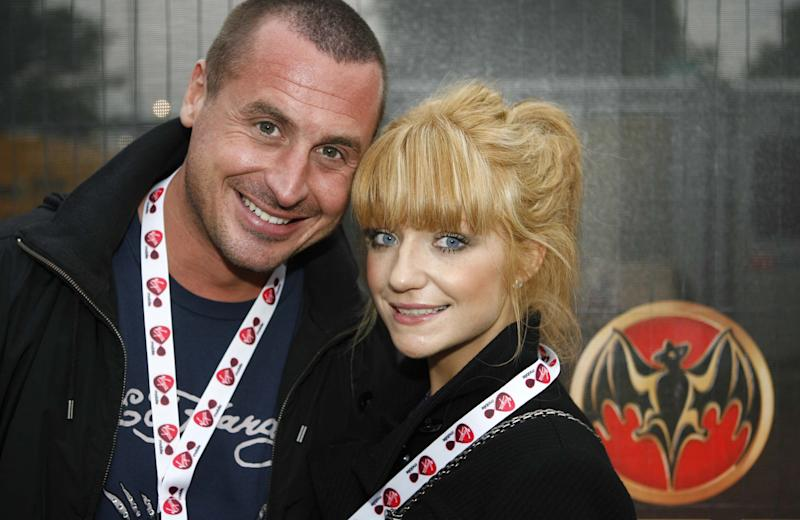 CHELMSFORD, UNITED KINGDOM - AUGUST 18: Carl Davies and Nicola Roberts from Girls Aloud attend the V - Festival day 2, Bacardi B Live backstage area in Hylands Park on August 19, 2007 in Chelmsford, United Kingdom (Photo by Simon Seed/WireImage)