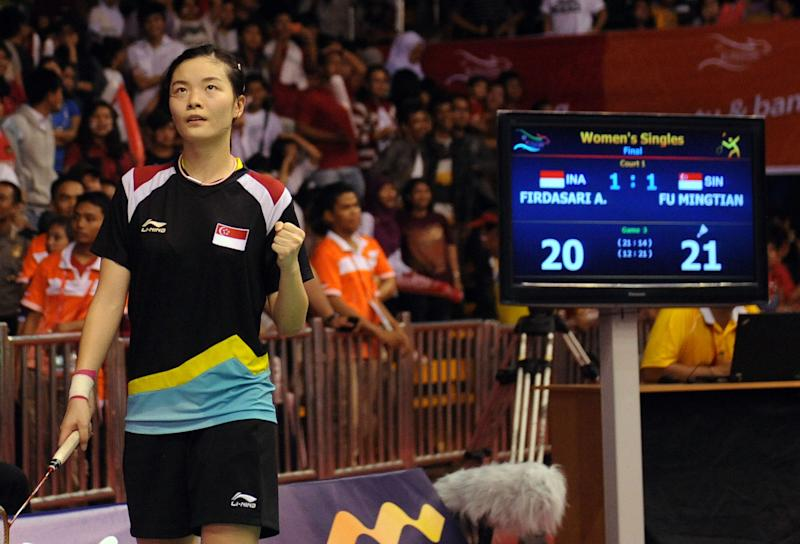 Fu Mingtian of Singapore gestures as she plays against Firdasari Adryanti of Indonesia during the badminton individual final at the 26th Southeast Asian Games (SEAGAMES) in Jakarta on November 19, 2011. Fu won the match to take home the gold medal. AFP PHOTO / ADEK BERRY (Photo credit should read ADEK BERRY/AFP via Getty Images)