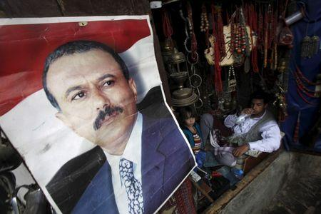 A poster of Saleh is seen on a door of a shop in an old quarter of Yemen's capital Sanaa