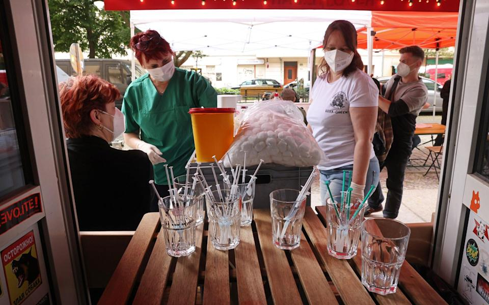 Medical assistants vaccinate people with the Johnson & Johnson Covid-19 vaccine at the Revolte Bar in Berlin, Germany on June 13 2021 - Sean Gallup/Getty Images