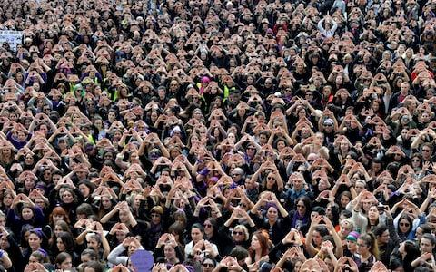 Protesters form triangles with their hands during a demonstration for women's rights in Bilbao, Spain, March 8, 2018 - Credit: VINCENT WEST/REUTERS