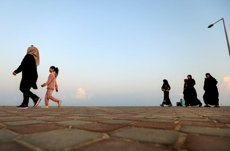 Palestinians walk on the beachfront of the Gaza Strip in a bid to escape the confinement of coronavirus restrictions -- which come on top of the Israeli blockade of the enclave