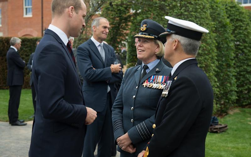 Prince William, Duke of Cambridge speaks to Group Captain Teresa Griffiths (C), the Commanding Officer at DMRC Headley Court, and Surgeon Commodore Andrew Hughes (R). - Getty Images Europe