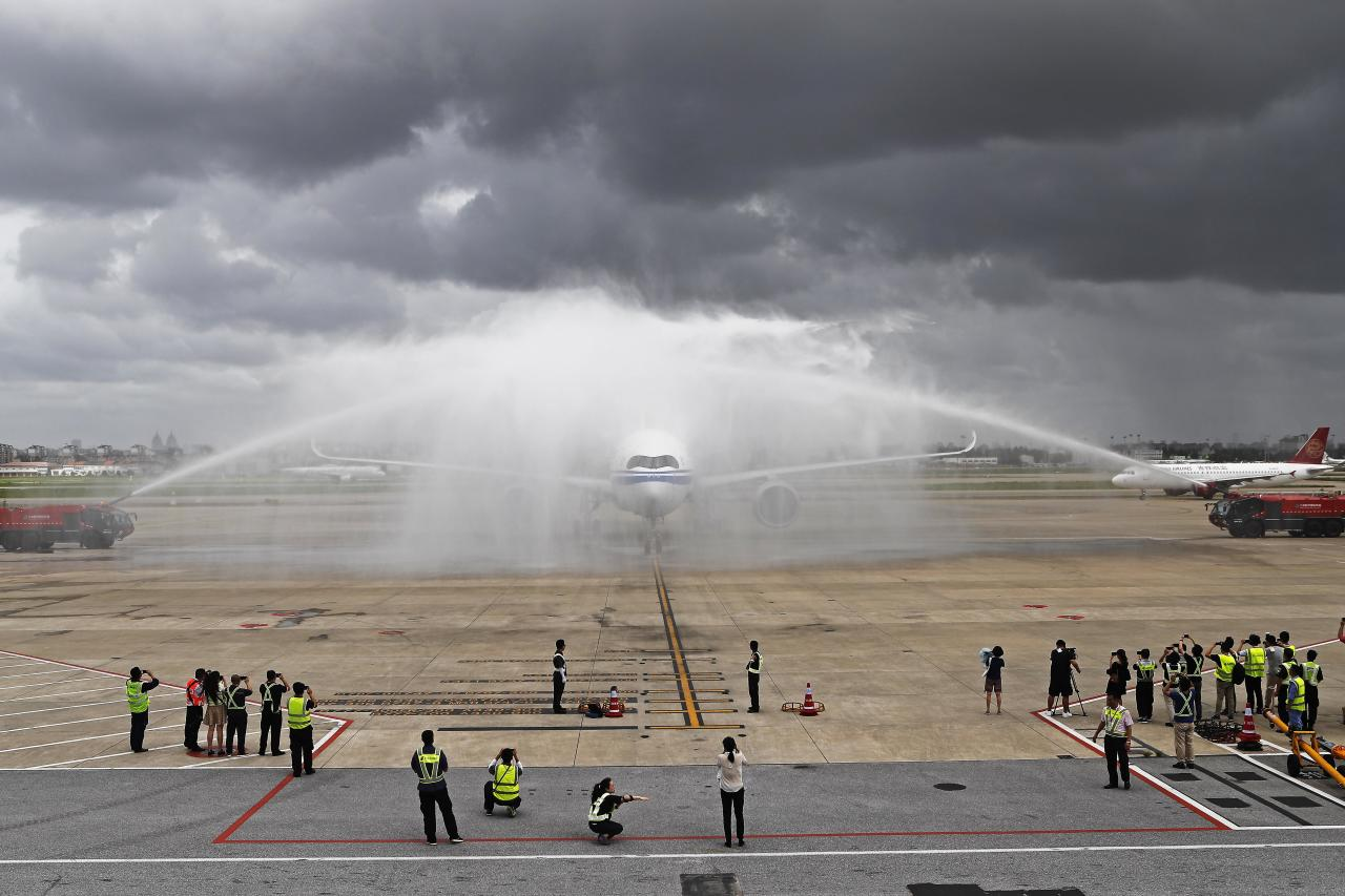 <p>The Airbus A350-900 of Air China is seen during a water salute at Shanghai Hongqiao International Airport on August 14, 2018 in Shanghai, China. The Airbus A350-900 of Air China made its maiden flight from Beijing Capital International Airport to Shanghai Hongqiao International Airport on Tuesday with more than 300 passengers on board. (Photo by Yin Liqin/China News Service/VCG via Getty Images) </p>