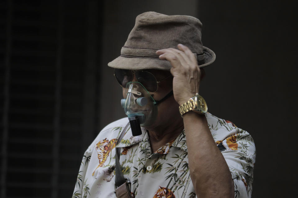 An elderly man wears an acrylic mask while walking on Juarez Avenue near the main square of Mexico City's Zocalo during the COVID-19 health emergency and the orange epidemiological traffic light in the capital.  According to Johns Hopkins University, Mexico is the thirteenth most infected country in the world and has the third highest number of deaths due to the pandemic, behind the United States and Brazil. On April 10, 2021 in Mexico City, Mexico. (Photo by Gerardo Vieyra/NurPhoto via Getty Images)