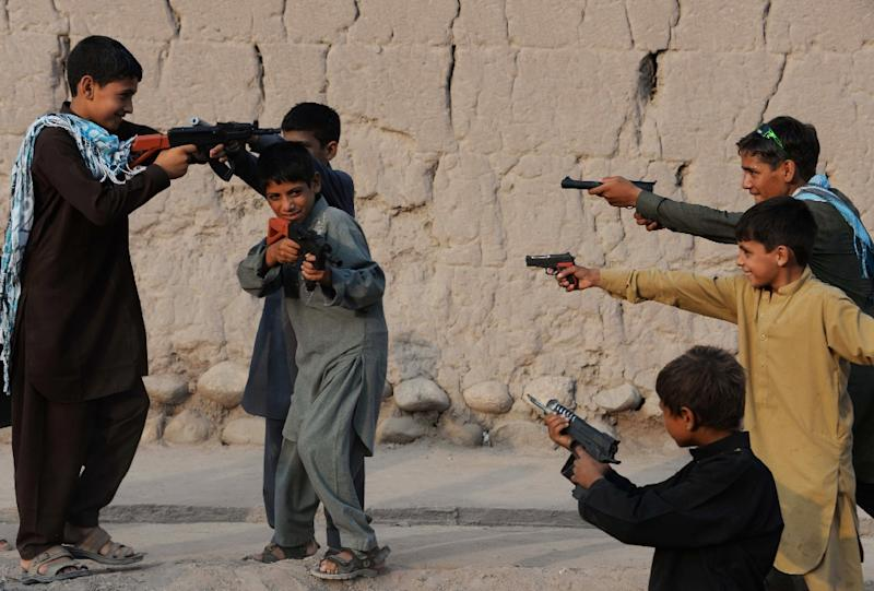 Children play with plastic guns in Jalalabad, Afghanistan as they celebrate Eid al-Fitr and the end of the fasting month of Ramadan on July 29, 2014