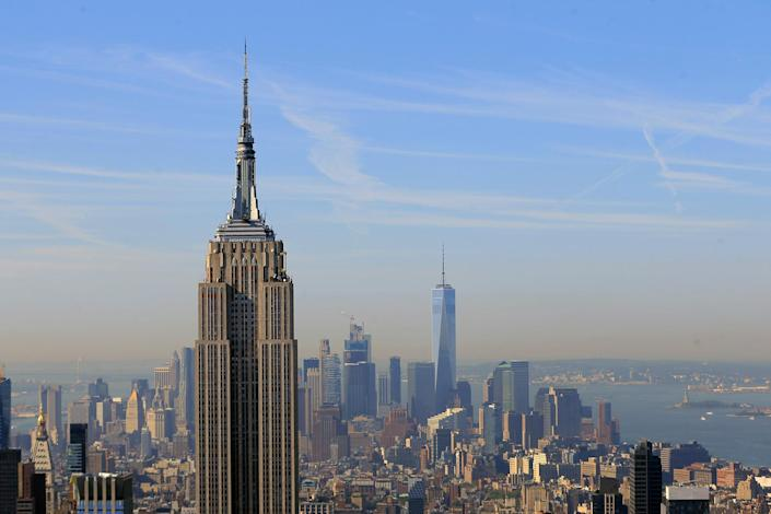 <p>One World Trade Center fills the skyline behind the Empire State Building in Aug. 29, 2016. (Gordon Donovan/Yahoo News) </p>