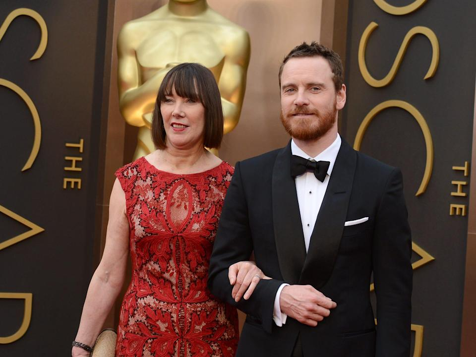 Michael Fassbender and his mom at the Oscars in 2014.