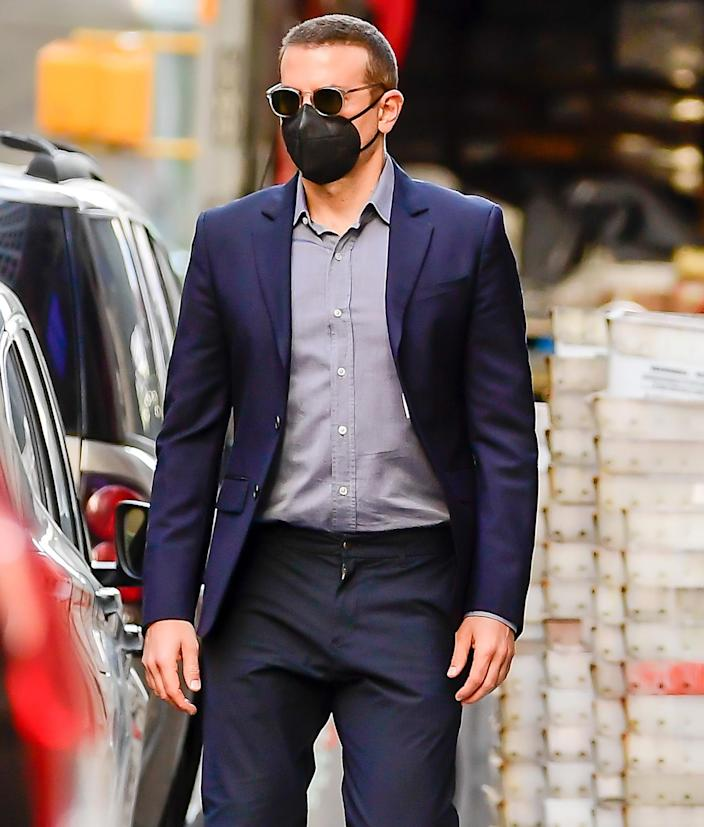 <p>Bradley Cooper keeps covered during an outing in N.Y.C. on Thursday.</p>