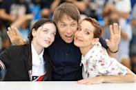 <p>Suzanna Son and Bree Elrod pose with director Sean Baker at the photo call for <i>Red Rocket</i> at Cannes on July 15.</p>