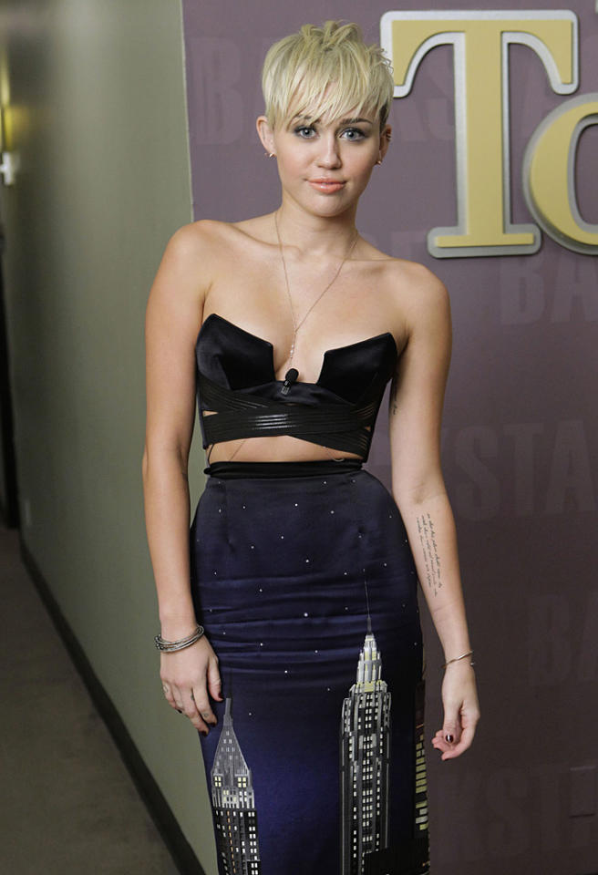 <b>#10: Miley Cyrus</b><br> It's no surprise that Miley Cyrus is in the top 10 of celebrities who were the most-searched this year – after all, she has given us <em>plenty</em> of reasons to type her name in whether it was to gawk at near-daily pics of her heading to Pilates, her ever-changing hair styles, too-cute dogs, or that gorgeous 3.5-carat engagement ring Liam Hemsworth gave her in May.