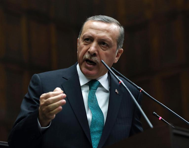 Turkey's Prime Minister Recep Tayyip Erdogan addresses his supporters at the parliament in Ankara, Turkey, Tuesday, Jan. 14, 2014. Turkish anti-terrorism police carried out raids in six cities on Tuesday, detaining at least five people with alleged links to al-Qaida, including an employee of a prominent Islamic charity group that provides aid to Syria, media reports and officials said.(AP Photo)