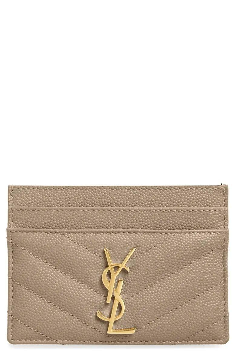<p>Go above and beyond by surprising them with this luxe <span>Saint Laurent Monogram Quilted Leather Credit Card Case</span> ($275).</p>