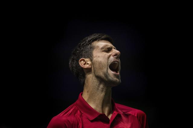 Serbia's Novak Djokovic reacts during the Davis Cup tennis match against France's Benoit Paire in Madrid, Spain, Thursday, Nov. 21, 2019. (AP Photo/Bernat Armangue)