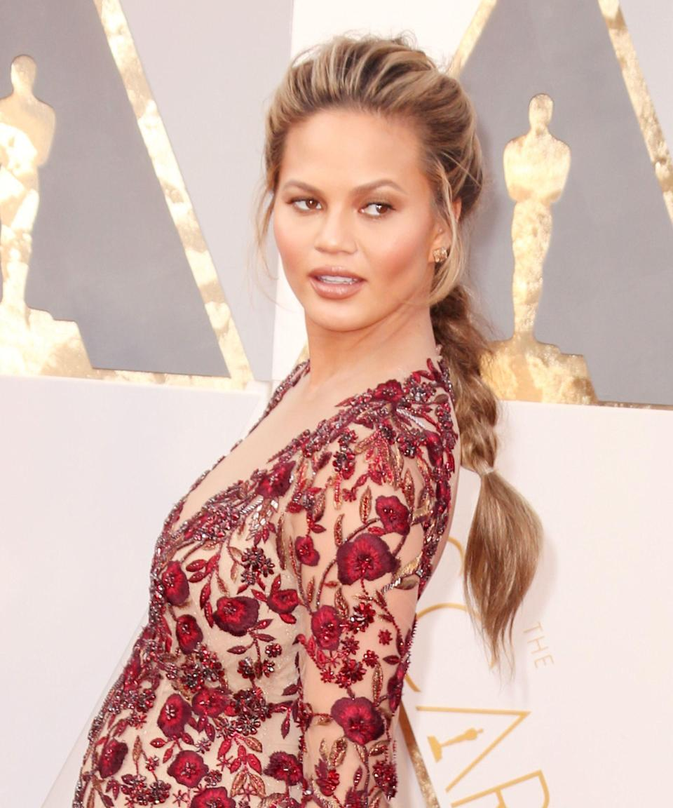 """<p><strong>Chrissy Teigen, 2016</strong></p><p>Sure, Chrissy Teigen's Rapunzel-like braid looks cool from the front, but check out the <a href=""""http://www.thedrawingroomny.com/wp-content/uploads/chrissy-copy-f554da2f-47ad-4d95-9296-07fc7296cbda.jpg"""" rel=""""nofollow noopener"""" target=""""_blank"""" data-ylk=""""slk:detail"""" class=""""link rapid-noclick-resp"""">detail</a>: a cluster of smaller, uneven plaits join a single voluminous braid down her back.</p><span class=""""copyright"""">Photo: Todd Williamson/Getty Images.</span>"""