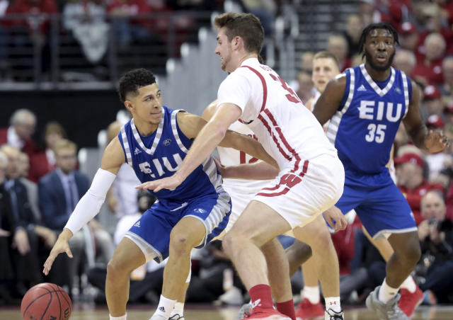 Eastern Illinois guard Shareef Smith, left, looks for a lane against the defense of Wisconsin's Nate Reuvers (35) during the first half of an NCAA college basketball game in Madison, Wis., Friday, Nov. 8, 2019. (John Hart/Wisconsin State Journal via AP)