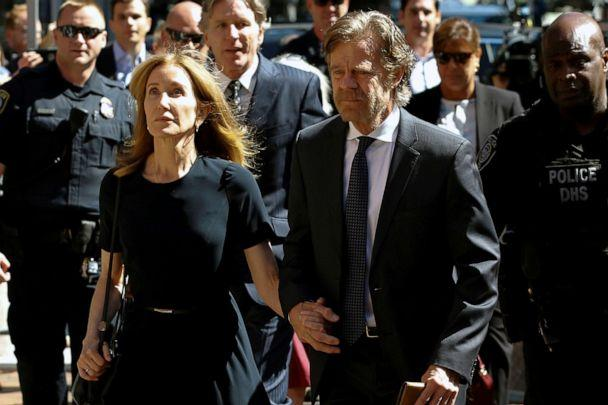PHOTO: Actress Felicity Huffman arrives at the federal courthouse with her husband William H. Macy, before being sentenced in connection with a nationwide college admissions cheating scheme in Boston, Massachusetts, Sept. 13, 2019. (Katherine Taylor/Reuters)