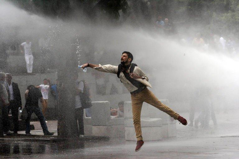 A protester faces a water cannon during clashes with riot police at a demonstration in Ankara on June 16, 2013. Two of Turkey's main trade unions began a nationwide strike to protest at police violence against anti-government demonstrators, a day after Prime Minister Recep Tayyip Erdogan defended his crackdown on an Istanbul protest park
