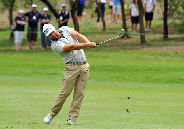 Ryan Moore of the USA on the 1st fairway on the third day at Sun City South Africa, Saturday, Dec 7, 2013. Moore is lying second on -13(AP Photo)