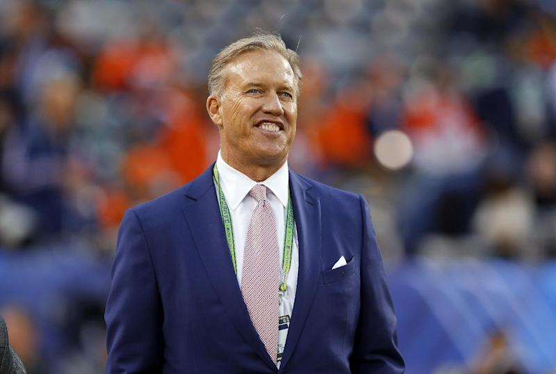 In this Feb. 2, 2014 file photo, Denver Broncos Executive Vice President of Football Operations John Elway watches during warmups before the NFL Super Bowl XLVIII football game at MetLife Stadium in East Rutherford, N.J. Broncos have extented Elway's contract for three years and added general manager to his title