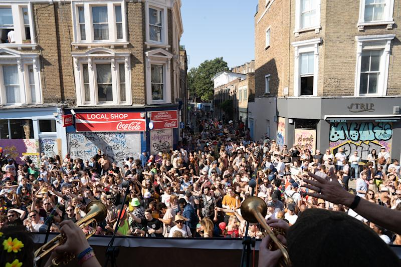 People dance on the streets of Notting Hill, west London, during the carnival.