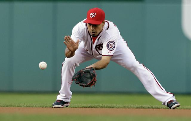 Washington Nationals second baseman Anthony Rendon (6) fields a ball hit by San Francisco Giants' Brandon Crawford during the first inning of a baseball game at Nationals Park Wednesday, Aug. 14, 2013, in Washington. (AP Photo/Alex Brandon)