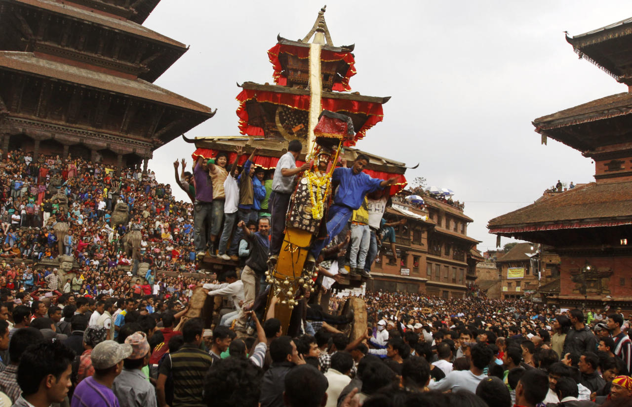 Locals pull a chariot containing images of Bhairava and Bhadrakali around the city as they celebrate the Bisket Jatra Hindu festival on the outskirts of Katmandu, Nepal, Monday, April, 9, 2012. During this festival, also regarded as a New Year festival, images of the god Bhairava and his female counterpart Bhadrakali are enshrined in two large chariots and pulled to an open square after which rituals and festivities are carried out. (AP Photo/Binod Joshi)