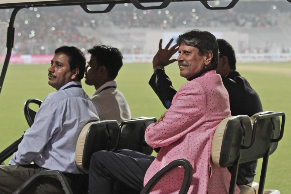 Former Indian cricketer Kapil Dev acknowledges the crowd during a grand parade of India's former cricket captains during the first day of the second test match between India and Bangladesh, in Kolkata, India, Friday, Nov. 22, 2019. (AP Photo/Bikas Das)