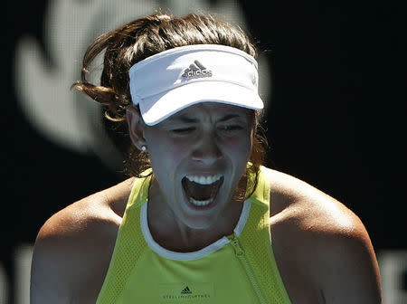 Tennis - Australian Open - Rod Laver Arena, Melbourne, Australia, January 18, 2018. Garbine Muguruza of Spain reacts during her match against Hsieh Su-Wei of Taiwan. REUTERS/Thomas Peter