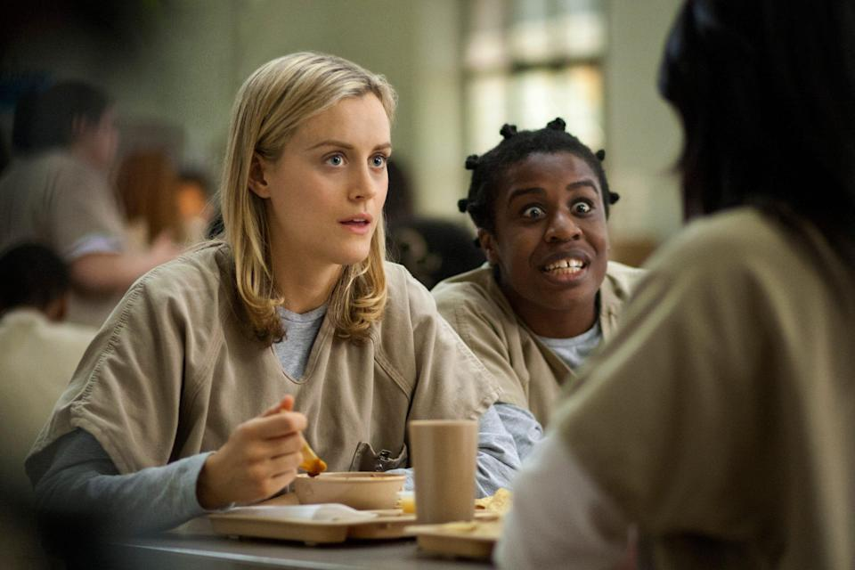 "Taylor Schilling, left, and Uzo Aduba in a scene from ""Orange is the New Black."""