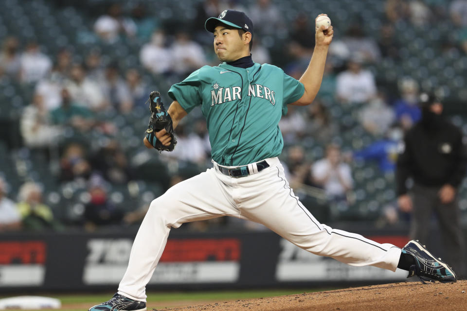 Seattle Mariners starting pitcher Yusei Kikuchi throws to a Houston Astros batter during the third inning of a baseball game Friday, April 16, 2021, in Seattle (AP Photo/Jason Redmond)