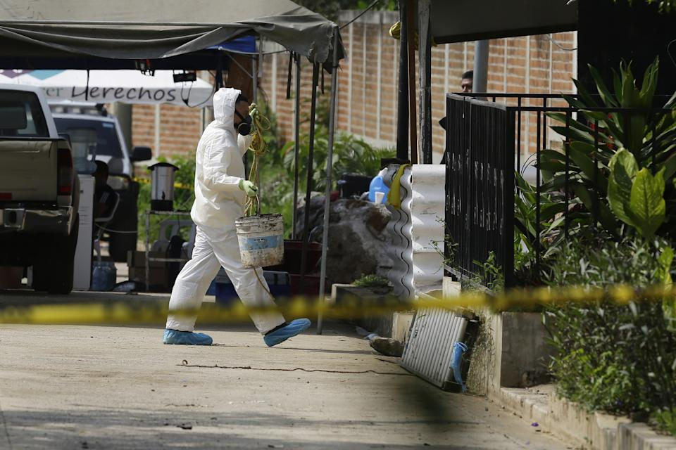Forensic teams at the home of Hugo Ernesto Osorio, who is being investigated for homicide.
