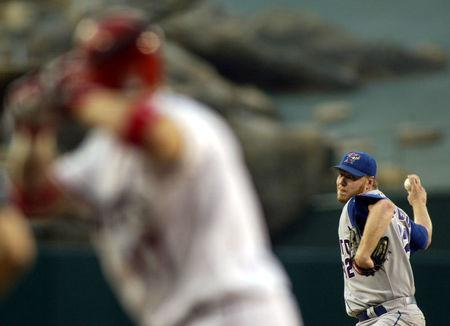 FILE PHOTO - Toronto Blue Jays' pitcher Roy Halladay throws in the first inning against Darin Erstad of the Anaheim Angels (L) during their game in Anaheim, California, August 1, 2003. REUTERS/Robert Galbraith
