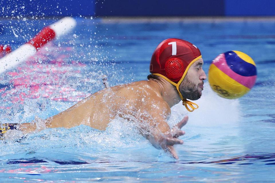 <p>Montenegro goalie Slaven Kandic attempts to make a save during the men's classification match against Italy.</p>