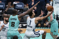 Memphis Grizzlies forward Kyle Anderson (1) drives to the basket around Charlotte Hornets center Bismack Biyombo (8) during the second half of an NBA basketball game in Charlotte, N.C., Friday, Jan. 1, 2021. (AP Photo/Jacob Kupferman)